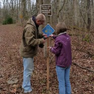 Winter trails cell phone tour signage erection